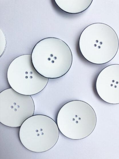 White with fine black rim four hole bowl satelite shape matt plastic button